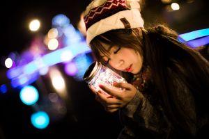 sweater closed eyes hands glass jar scarf woolly hat women bokeh night portrait dark lights asian women outdoors brunette