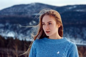 sweater looking into the distance depth of field blonde snow women women outdoors model portrait mountains blue eyes