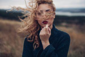 sweater women outdoors blonde model portrait red lipstick depth of field hair in face looking at viewer women