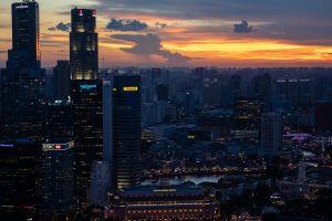 the fullerton hotel singapore lights sunset building cityscape