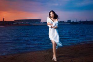tiptoe tattoo barefoot sunset bare shoulders women women outdoors white dress alexander drobkov water windy