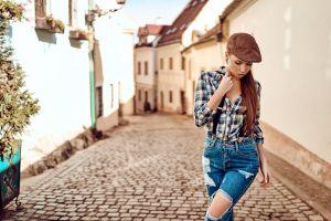 torn jeans plaid shirt portrait women suspenders