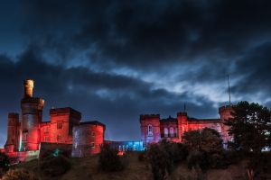 tower sky clouds castle lights red night