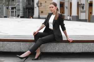 vest alexey polskiy urban white tops model women high heels public ponytail sitting women outdoors black jackets