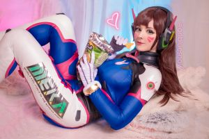 video game girls eyeliner indoors side view brunette women overwatch blue snow long hair d.va (overwatch) lying on back headphones cosplay smiling model