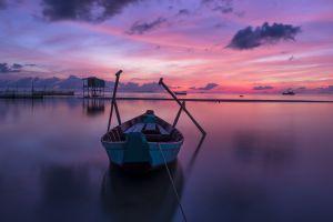 vietnam pink boat calm sea horizon