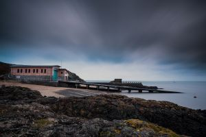 wales pier landscape clouds water nature sea house rock long exposure horizon