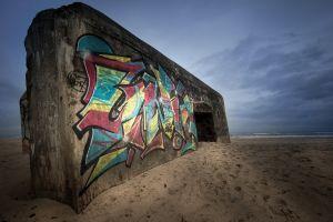 wall horizon shore graffiti beach sand sea clouds