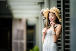 watch women outdoors women with hats model portrait glasses women outdoors depth of field asian dress smiling brunette looking into the distance hat