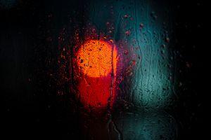 water on glass rain depth of field blurred minimalism orange lights bokeh black background water drops