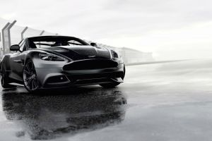 wet aston martin car sports car monochrome grey cars vehicle