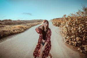 windmill brunette road belly women outdoors model asian sky women black tops jean shorts smiling