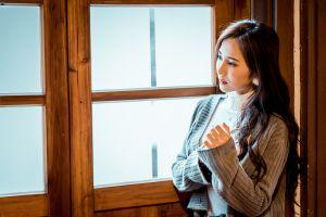 window dark hair asian women