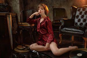 women brunette chair satin model finger on lips short hair barefoot legs depth of field indoors typewriters tiptoe on the floor couch