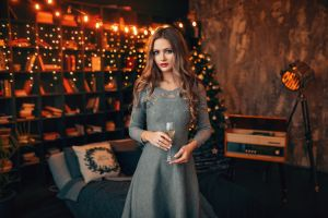 women drinking glass christmas tree bed dress christmas red lipstick painted nails portrait