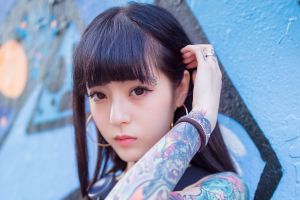 women face tattoo asian