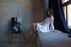 women indoors bare shoulders sitting dress sensual gaze white dress looking at viewer barefoot legs women painting brunette
