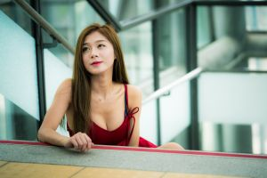 women indoors women necklace brunette looking into the distance red dress asian model