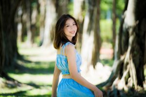 women looking at viewer smiling women outdoors model crop top asian looking over shoulder depth of field trees brunette