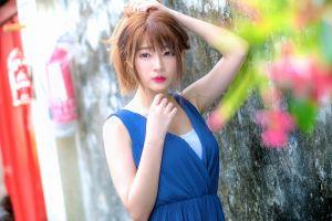 women outdoors dress arms up blue dress asian women hands in hair portrait redhead
