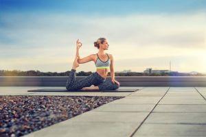 women outdoors model nike sky rooftops blonde hairbun michael kleber yoga women barefoot yoga pants sports bra