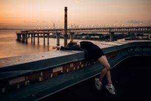 women outdoors sneakers sunset dress arched back bridge brunette