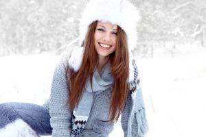women outdoors snow woolly hat sweater hat model women fluffy hat snowing winter brunette scarf smiling