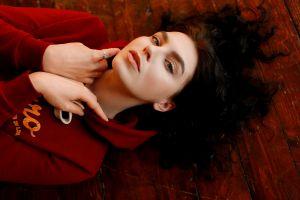 women portrait sweater on the floor face wooden surface