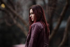women red jackets depth of field redhead profile model women outdoors looking into the distance leather jackets