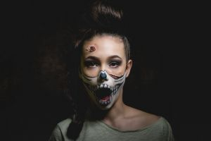 women skull makeup open mouth simple background