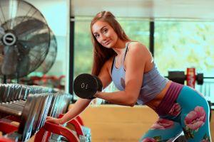 women smiling gyms fitness model dumbells