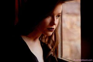 women window looking away emily bloom brunette