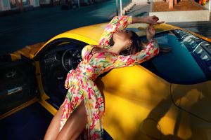 women with cars max sokolovich street cleavage depth of field dress yellow cars women outdoors women brunette car closed eyes model ford mustang outdoors