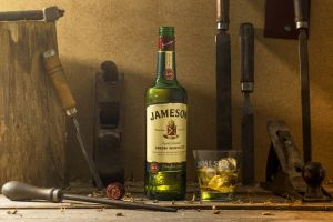 wood bottles drinking glass jameson whiskey still life ice cubes alcohol hammer