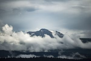 zoom lens mountains snowy peak clouds caucasus mountains
