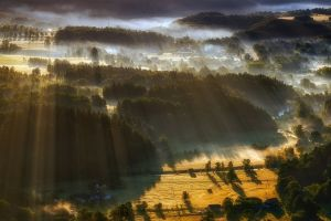 aerial view landscape sun rays hills forest villages nature field mist trees