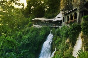 architecture arch cliff waterfall old building trees forest switzerland rock nature
