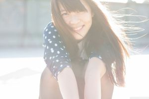 asian redhead long hair overexposed smiling women windy hair in face bangs
