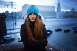 auburn hair snow brunette women woolly hat depth of field hat looking at viewer women outdoors lipstick winter long hair city