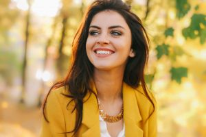 aurela skandaj smiling women looking away yellow jacket model