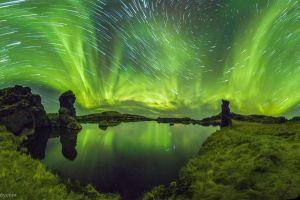 aurorae lake grass landscape blurred stars long exposure reflection