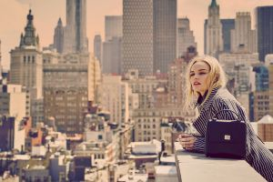 bag open mouth building coats blonde city women outdoors kate bosworth rooftops women actress urban long hair depth of field windy