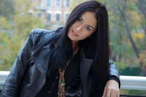 balcony macy b smiling women looking at viewer leather jackets jacket black hair open mouth model