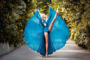ballerina legs up looking up blue dress women women outdoors