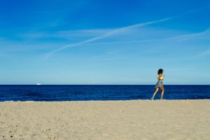 beach women run women water sea running sea water coast run nature coast running landscape