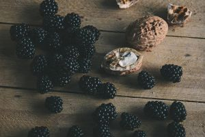 berries walnuts food wooden surface fruit