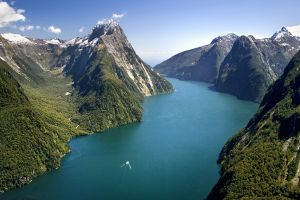 bird's eye view forest nature landscape clouds boat new zealand water mountains milford sound milford sound trees snow river