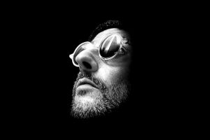 black background jean reno léon: the professional monochrome sunglasses