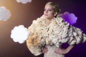 blonde clouds white dress blue eyes hands on hips makeup