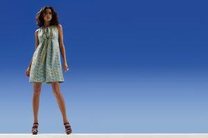blue background brunette rings dress